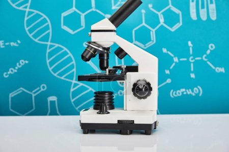 microscope on blue background with molecular structure