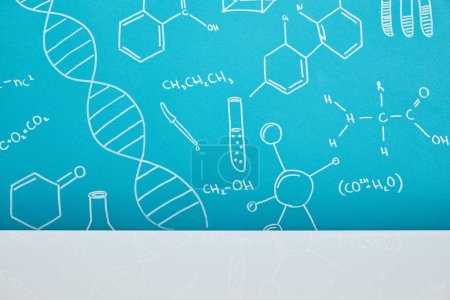 blue background with molecular structure signs near white surface
