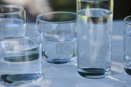 Photo for Clear fresh water in transparent glasses on wooden table - Royalty Free Image