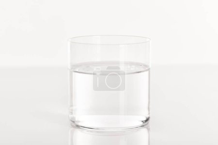 clear fresh water in transparent glass isolated on white