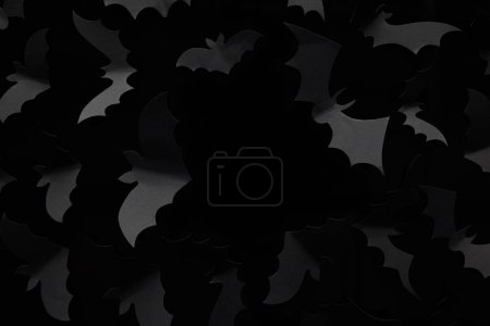 Photo for Top view of paper bats on black background, Halloween decoration - Royalty Free Image
