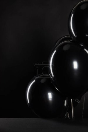 Photo for Bunch of black balloons isolated on black, black Friday concept - Royalty Free Image