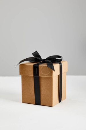 Photo for Cardboard gift box with black ribbon isolated on grey, black Friday concept - Royalty Free Image