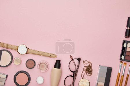 top view of decorative cosmetics isolated on pink