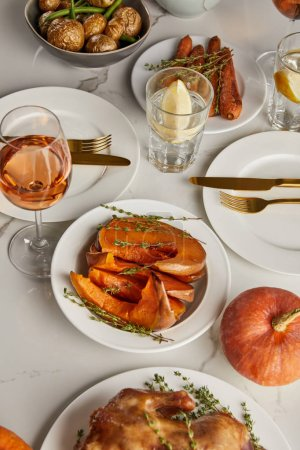Photo for Traditional thanksgiving dinner with baked vegetables served on marble table - Royalty Free Image