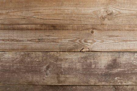 Photo pour Top view of wooden textured desk with copy space - image libre de droit