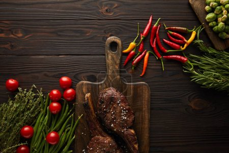 Photo for Top view of meat, chili peppers, cherry tomatoes, green peas, greenery, brussels sprouts - Royalty Free Image