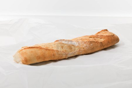 fresh baguette on textured white background