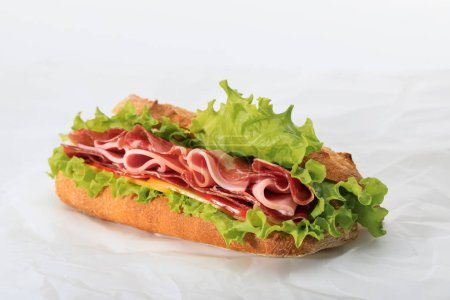 Photo for Fresh sandwich with lettuce, ham, cheese, bacon and tomato on textured white background - Royalty Free Image