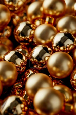 close up view of shiny golden Christmas baubles