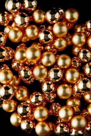 Foto de Top view of shiny golden Christmas balls isolated on black - Imagen libre de derechos