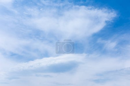 white clouds in blue sky in summertime