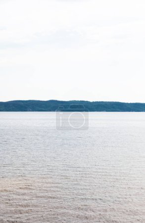 Photo for Clean and blue lake against sky in summer - Royalty Free Image