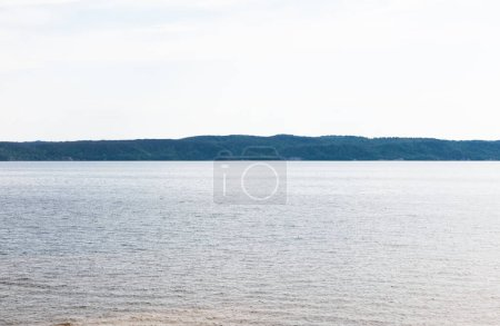 Photo for Sunshine on tranquil lake against sky with clouds - Royalty Free Image