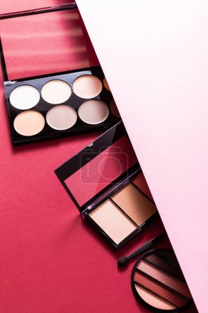 pastel eye shadow and blush palettes on pink and crimson
