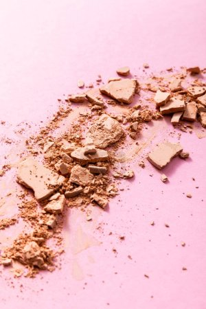 beige and crushed face powder on pink