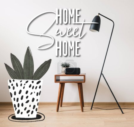 Photo for Floor lamp, wooden coffee table, clock with blank screen and home sweet home lettering near drawn plant illustration - Royalty Free Image