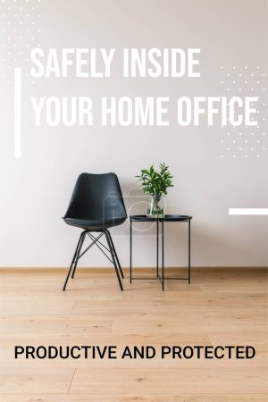Photo pour Table basse noire avec plante verte près de chaise moderne et en toute sécurité à l'intérieur de votre bureau à domicile, lettrage productif et protégé - image libre de droit