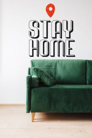 Photo for Green sofa with pillow near stay home lettering - Royalty Free Image