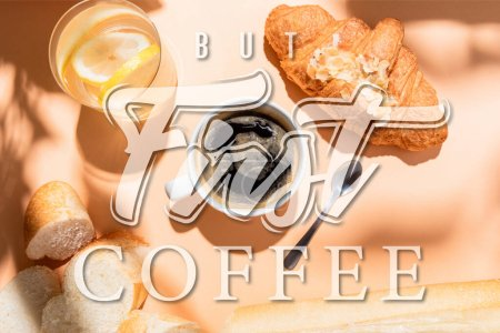 Photo for Top view of coffee, water, baguette and croissant for breakfast on beige table with but first coffee lettering - Royalty Free Image