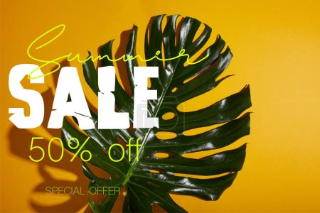 top view of tropical green leaf on yellow background with summer sale illustration