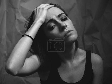 Photo for Depressed young woman. Studio portrait. - Royalty Free Image