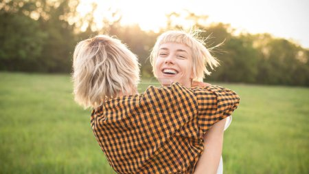 Two girls having fun and hugging outdoors. Best friends