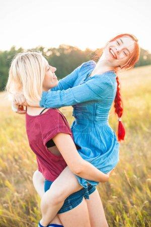 Two beautiful women having fun outdoors. Best friends