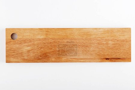 Elevated view of wooden cutting board isolated on white background