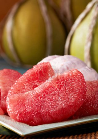 Photo for Close up of peeled grapefruit on the plate - Royalty Free Image