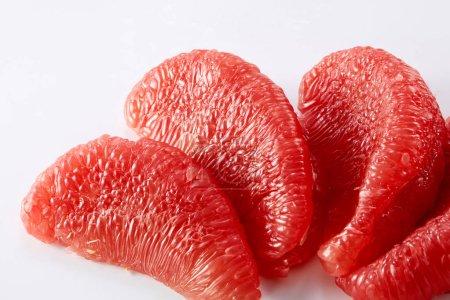 Photo for Close up of peeled grapefruit isolated on white background - Royalty Free Image