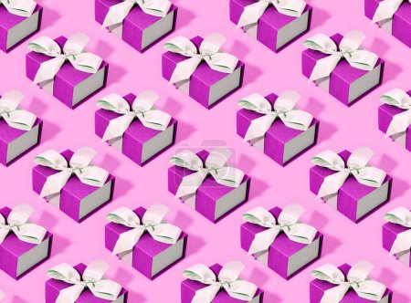 Pattern made of pink gift boxes.