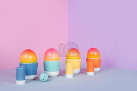 Photo for Painted eggs on pastel background. Creative minimal concept. - Royalty Free Image