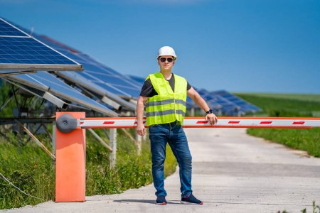 Photo for Engineering technician carries out on-site investigation at the new energy base. - Royalty Free Image