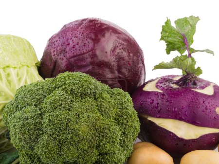 Whole cabbage, red turnip, radish, broccoli and potatoes isolated on a white background. A concept of organic vegetables, close-up