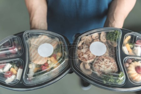 Photo for Collection of take away foil boxes with healthy food.n of take away foil boxes with healthy food.Healthy food in box. Fresh box . lifestyle, day meal plan - Royalty Free Image