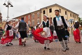 the folk dance ensemble Irizema from Bova Marina, Calabria, Italy, performs traditional dance tarantella in the town square during the International Folklore Festival, on August 2, 2015 in Russi, Ravenna, Italy