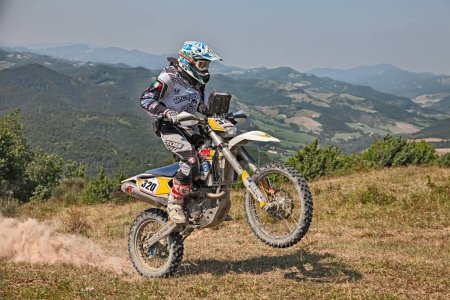 biker riding enduro motorcycles Husqvarna