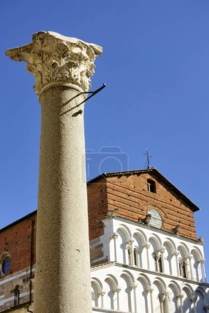 The Santa Maria Forisportam church in Lucca, Italy.This is  a fine example of Pisan Romanesque with the essentially linear facade in Marble with arcading and loggias.