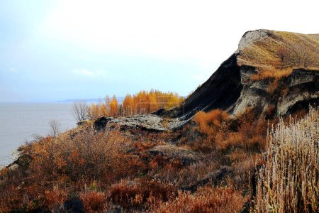 picturesque river clayey fall in autumn.