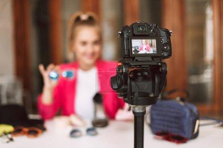 Close up black camera recording new video of fashion blogger