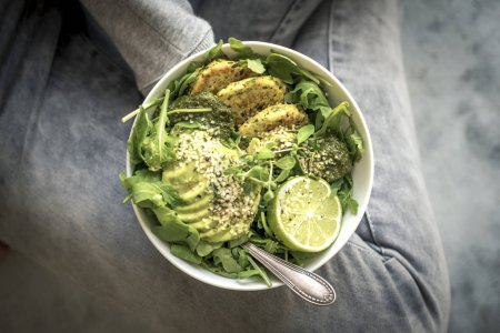 Photo for Green Fitness Breakfast Veggie Bowl with Falafel and Avocado - Royalty Free Image