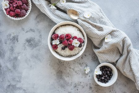 Photo for Rice semolina breakfast bowl with raspberries and blueberries - Royalty Free Image