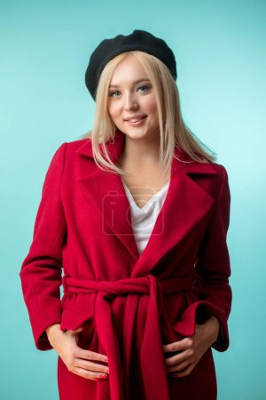 lady coating concept. beautiful cheerful teddy girl in red overcoat. elegance concept.