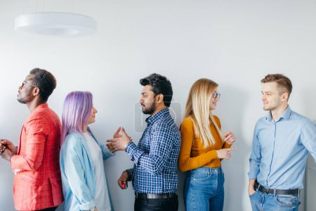 Multiethnic Group of Young People in Casual Wear isolated over grey background