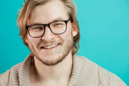 cheerful sportsman in glasses in casual outfit