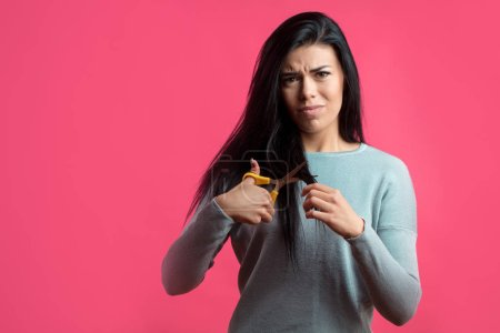 angry young woman is going to cut hair.