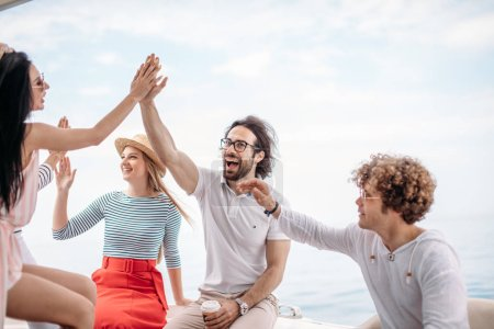 Group of friends making party on a yacht, having a fancy party on a luxury boat