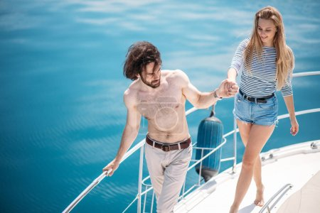 Hot dating lovers on the luxury boat in open sea in summer.
