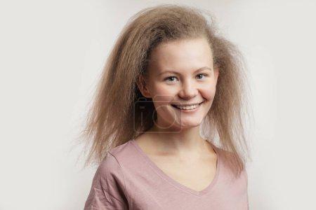 joyful charming girl with fair puffy hair